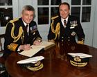 The new First Sea Lord Admiral Sir Philip Jones (left) and his predecessor Admiral Sir George Zambel
