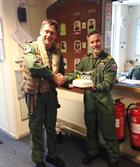 Lt Cdr Steve Hayton (left) receiving his 3000 hrs cake from Lt Cdr Iain Macfarlane
