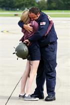 Chief Petty Officer Jim Wilkins hugs daughter Phoebe Wilkins (13)