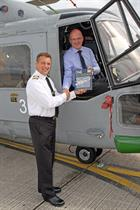 Handing over the first copy of the Lynx Manual to Cdr Phil Richardson at Yeovilton.  (credit: Steve