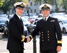 Commodore Jeremy Kyd (left) greets Commodore Andrew Betton OBE outside Victory Building prior to the