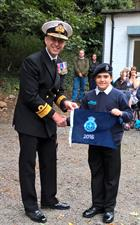 R. Admiral Blount presents Leading Junior Cadet Macfarlaine with the 2016 Burgee
