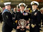 R Admiral Blount OBE, presents the Australia Shield to Cdr Brendan Spoors and LAET John Simpole of 8