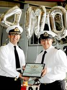 Rear Admiral Keith Blount presenting Si with a certificate for his 4000th Hour