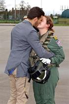 Lt Laura Cambrook is welcomed home by Husband Tom Lindsey at RNAS Yeovilton