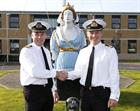 L- R Commodore Jon Pentreath hands over the reigns as Commanding Officer at RNAS Yeovilton to Commod