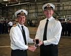 Rear Admiral Keith Blount presents Commander Simon Collins with his LSGC Medal