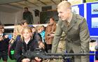 JPG Marine Luke Tanner shows off a GPMG to the School Children of Yeovil
