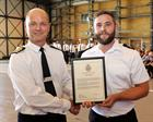 Leading Air Engineering Technician Harper receives his award for Junior Rate of the Year