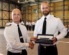 Lieutenant Hall receives his Fleet Air Arm Sword Award