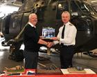 Phil Thomas presents Tiger striped Merlin to Capt Matt Briers RN CO CHF