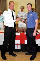 Commodore Paul Chivers OBE CO HMS Heron and AET Sam Lyndon