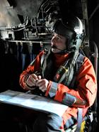 Cpl Justin Morgan in the back of the SAR helo