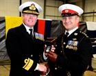Admiral Cunningham CBE presents Capt Barnwell RM with his Campaign Service Medal (Afghanistan)