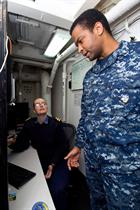 Lt Townsend discusses a forecast with a US Navy colleague