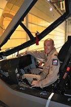 Lt Cdr IanTidball in mock-up cocpit of F-35