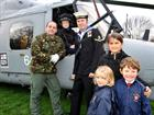 Lt Cdr Alex Sims and LET Marshall with children from St Alban's Primary School