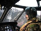 Sub Lt Dan Howes pilots his helicopter in the challenging terrain