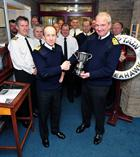Captain Willy Entwisle receives  Bambara Flight Safety Trophy from R.Adm Russ Harding