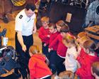 Petty Officer Austin Power showing the children a Helicopter gear box