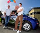 "Lt Will Scown, CPO Adam Marshall & Lt Jon Ford with their ""Rally-Car"", complete with Fist"