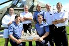 Victorious Field Gun Crew team members 2013 displaying the trophy