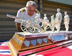 Commodore Jock Alexander inspects the trophy