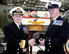 Admiral Harding presents medal to CPO Air Engineering Technician Russell Thompson